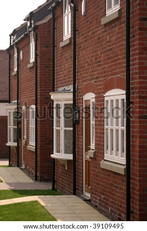 Two detached brick houses in UK - stock photo