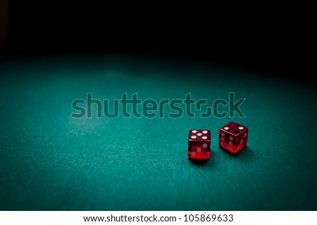 Two dice counting seven on a card table - stock photo