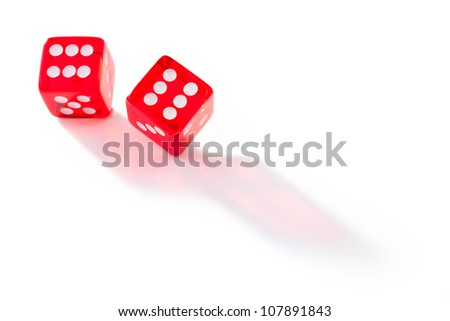 Two dices in motion against a white background - stock photo