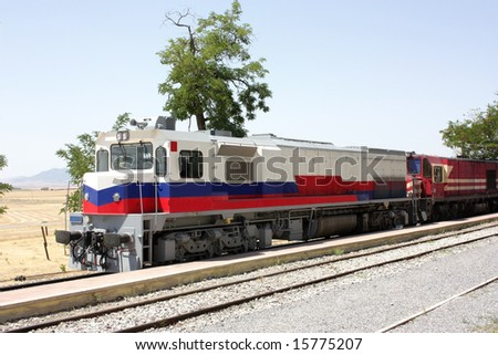 Two diesel locomotives in the station. Trees on background. - stock photo