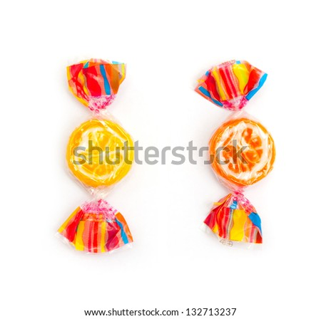 two different candies on white - stock photo