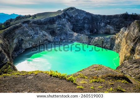 Two different coloured crater lakes at Kelimutu, Flores, Indonesia - stock photo
