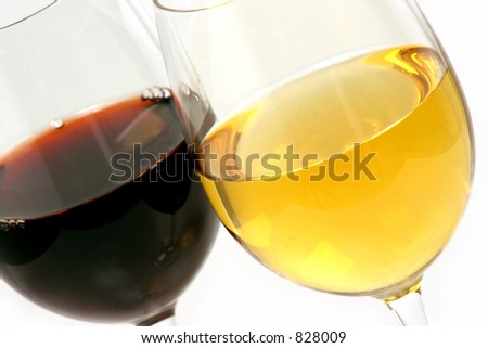 two different glasses of wine one white Chardonnay and one red Cabernet Sauvignon - stock photo