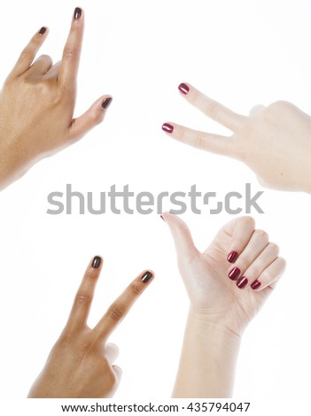 two different nathion manicured hands on white isolated, african with caucasian close up, gesturing, making shape - stock photo