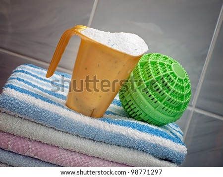 Two different ways of clothes washing, with detergents and a modern ball washer... - stock photo