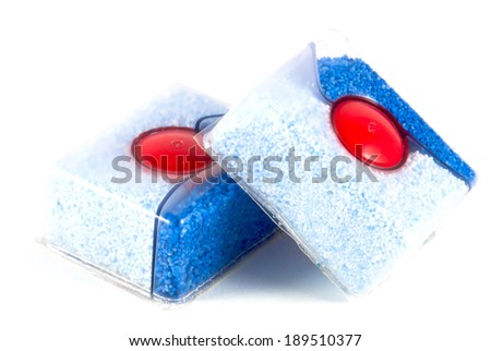 Two dishwasher tablets isolated on white. - stock photo