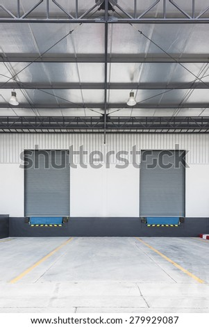 two Dock leveler and shutter door in Logistic Area - stock photo