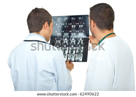 Two doctors men review magnetic resonance imaging and having conversation isolated on white background - stock photo