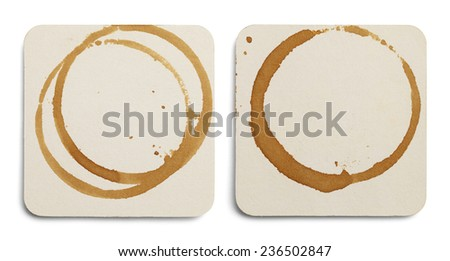 Two Drink Coasters with Coffee Stains Isolated on White Background. - stock photo