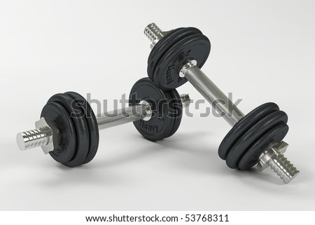 Two dumbbells leaning with clipping path - stock photo