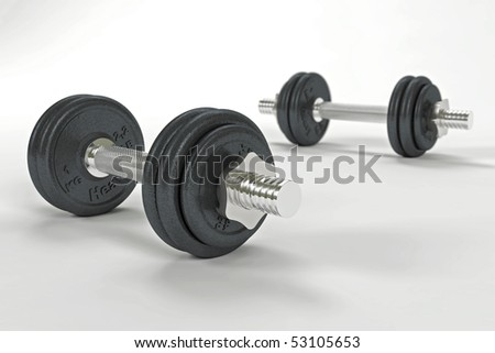 Two dumbbells with shallow depth of field - stock photo
