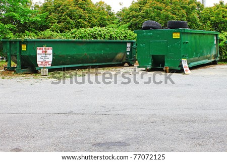 Two dumpster used for recycling many numerous items outside with room for your text - stock photo