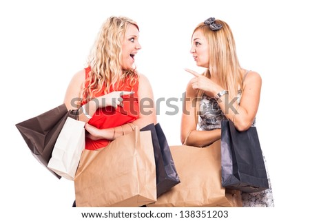 Two ecstatic girlfriends shopping, isolated on white background - stock photo