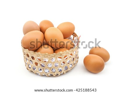 two eggs out of basket isolated on white background - stock photo