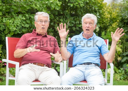 Two elderly men are having a lot of fun! - stock photo