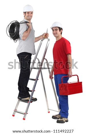 Two electrician with step ladder - stock photo