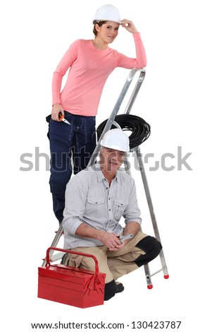 Two electricians starting new job - stock photo