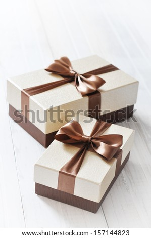 two elegant gift boxes on a light background - stock photo