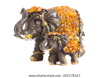 two elephants with amber for happiness - stock photo