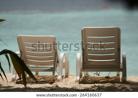 Two empty sunbed on the beach, beautiful seascape, relaxation on Maldives island - stock photo