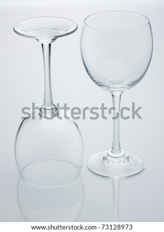 Two empty wine glasses on white background - stock photo