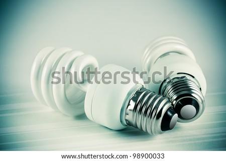 Two energy saving light bulbs - stock photo
