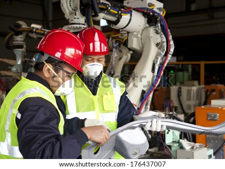 Two engineer discussing in factory - stock photo