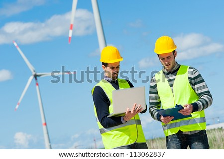 Two Engineers in a Wind Turbine Power Station, Italy - stock photo