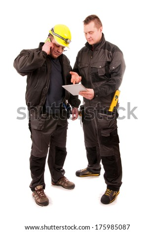 Two Engineers looking at tablet pc isolated on white background - stock photo