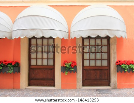 two entrances with nostalgic marquee, italy - stock photo