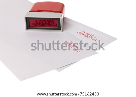 Two envelopes marked private and confidential with ared stamp on them - stock photo