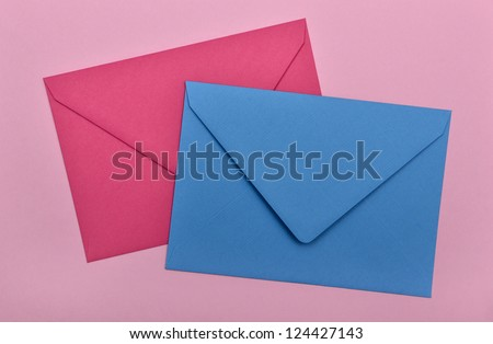 two envelopes on a pink background - stock photo