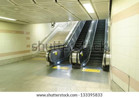 Two escalators in subway station - stock photo
