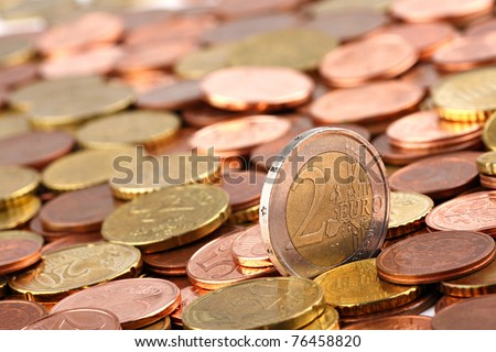 two EURO coin ina lot of EURO cent coins - stock photo