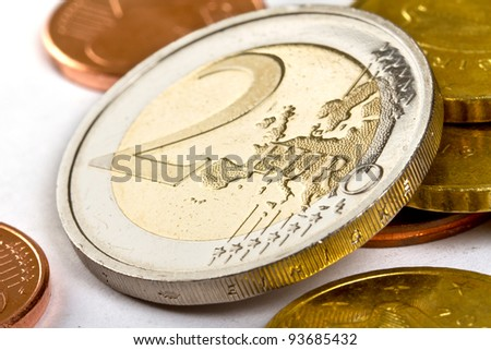 Two euro coin with small change - stock photo
