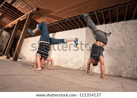 Two European Capoeria artists performing headstands - stock photo