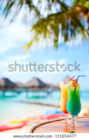 Two exotic cocktails in a tropical setting - stock photo