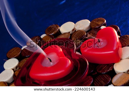 Two extinguished heart shaped candles   - stock photo