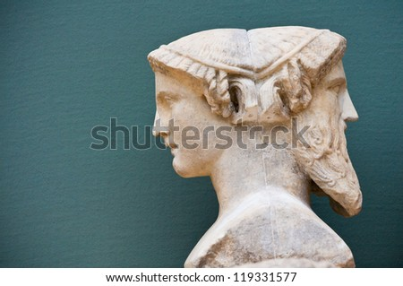 two faces of a person - historical sculpture - stock photo