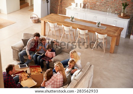 Two families spending time together at home - stock photo