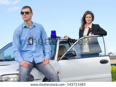 Two FBI agents near the car with flasher - stock photo