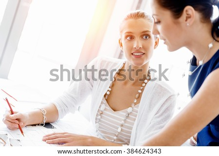 Two female colleagues in office - stock photo