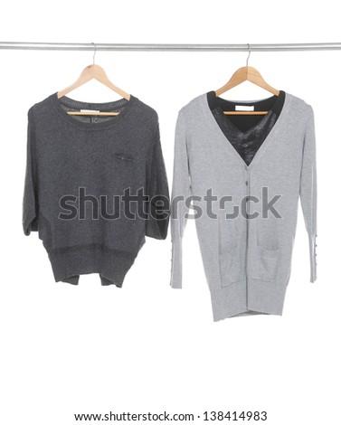 Two female dress isolated on hanging-black background - stock photo