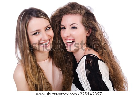 Two female friends isolated on the white - stock photo