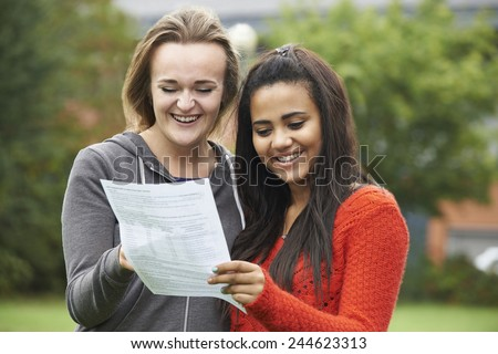 Two Female Students Celebrating Exam Results Together - stock photo