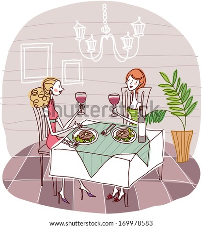 Two females dining at a restaurant with wine in hand. - stock photo
