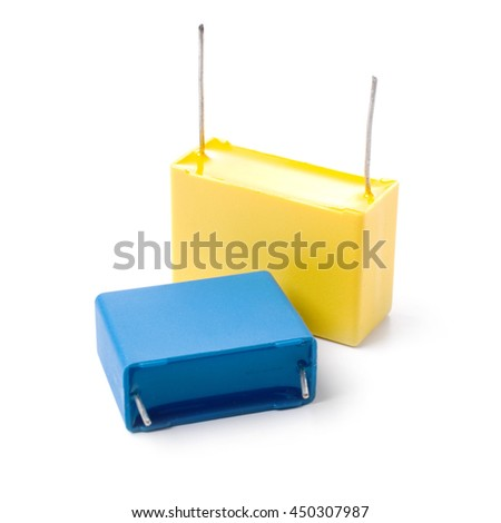 Two film capacitors isolated on white background. - stock photo