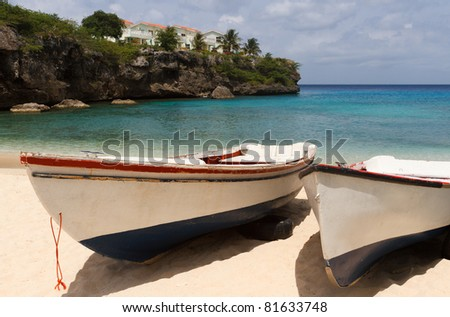 Two fishing boats at a secluded beach in Curacao - stock photo