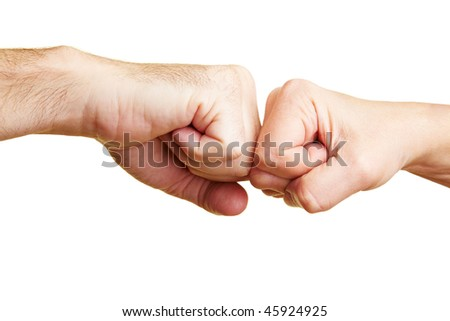 Two fists punching each other - stock photo