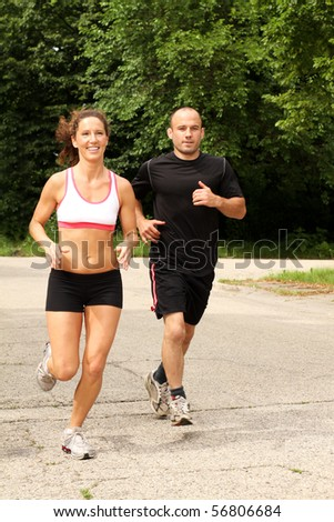Two fit people out for a jog - stock photo